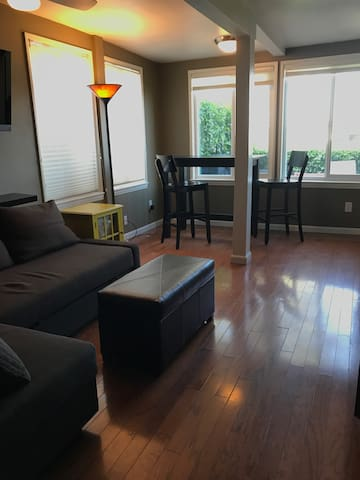 Open living space with hardwood floors