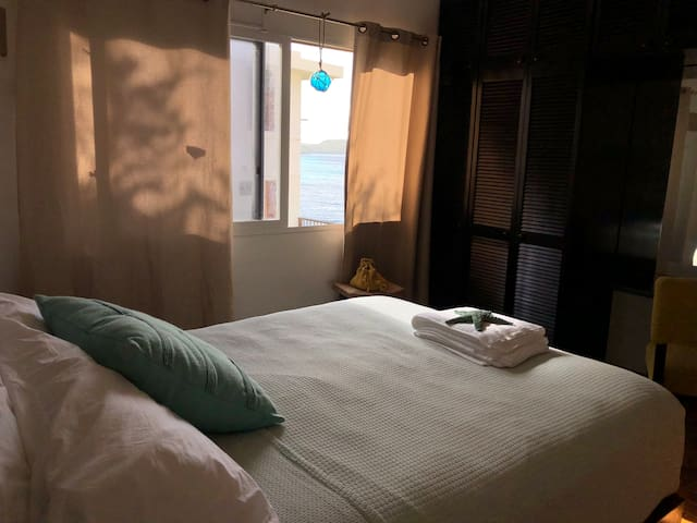 Master Bedroom with ocean views, queen sized bed,  and an en-suite bathroom