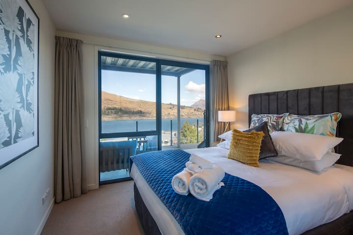 Bedroom 2 with Queen bed and lake view with access to balcony