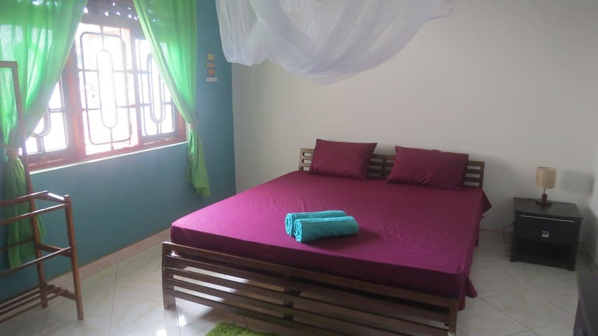 The sleeping room with kingsize bed. (spring mattress and moskito-net)