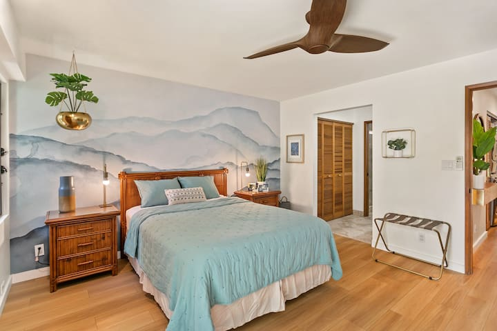 Our spacious bedroom with bathroom attached offers a desk as a workspace and access to a second private lanai.