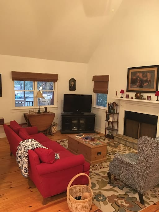 Comfortable living room with gas logs and tv with 190 channels.