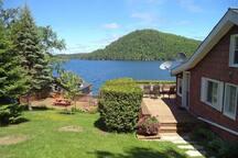 lawn beside cottage, showing 2 decks
