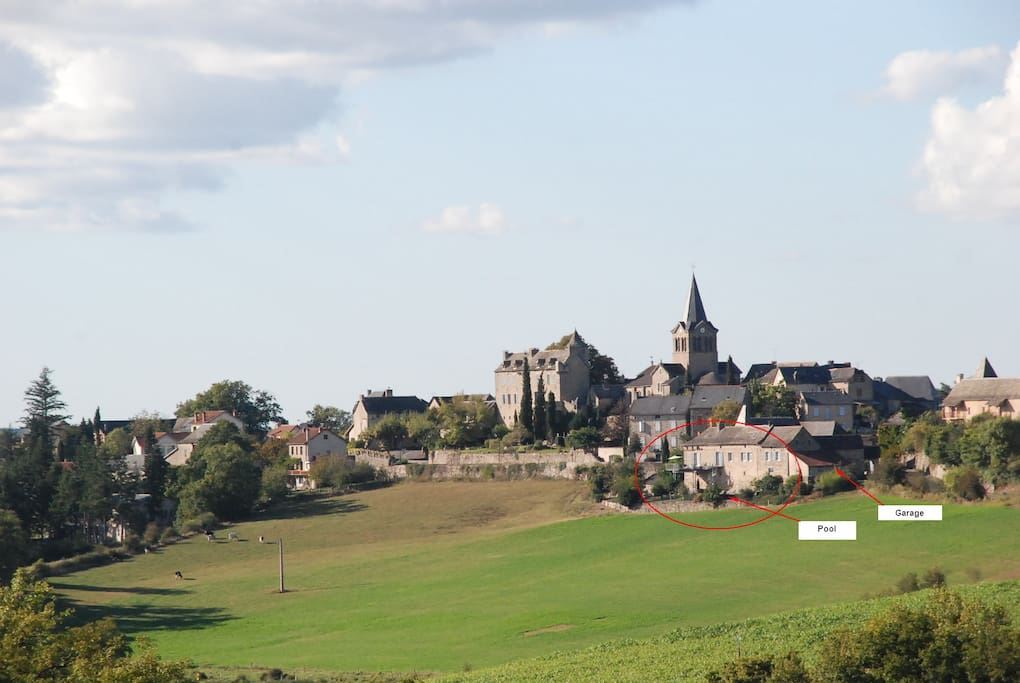 Farmhouse circled in red. View of the village of Lunac