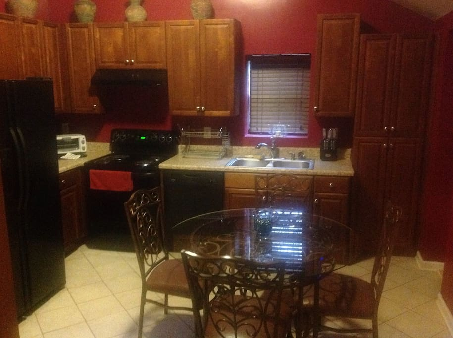 Eat in kitchen with all cooking/eating accessories available.