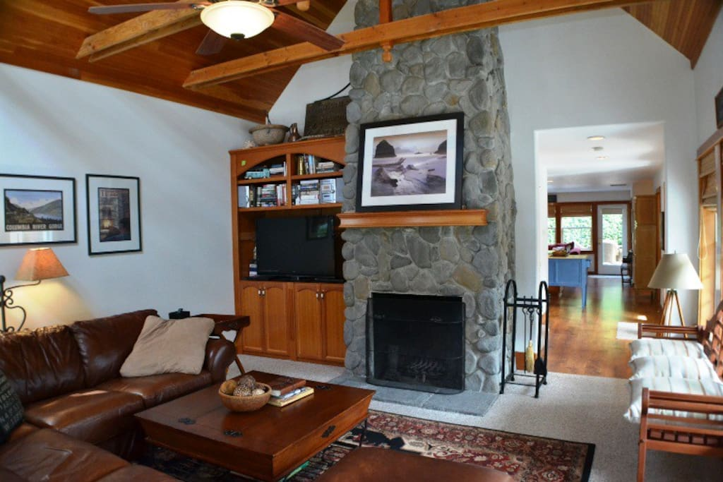 Living Room with Wood Burning Fireplace & Flat Screen TV