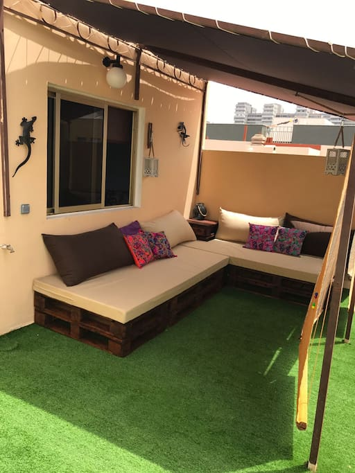 The roof terrace with comfortable sofa.