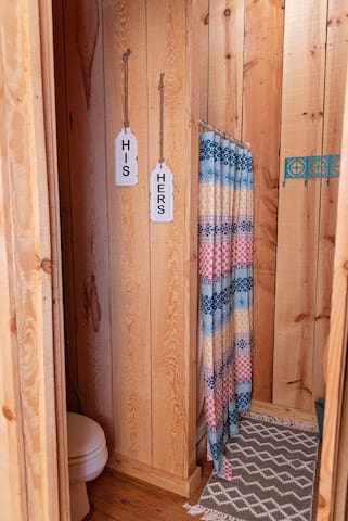 Bathroom offers a full shower with fresh towels!