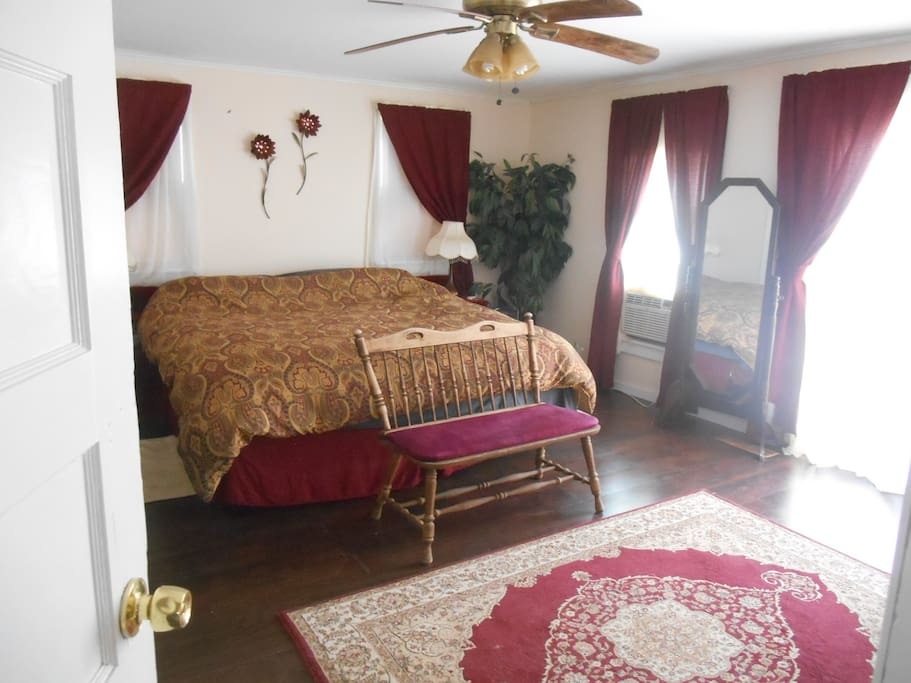 Master suite with King bed and walkout door to main deck