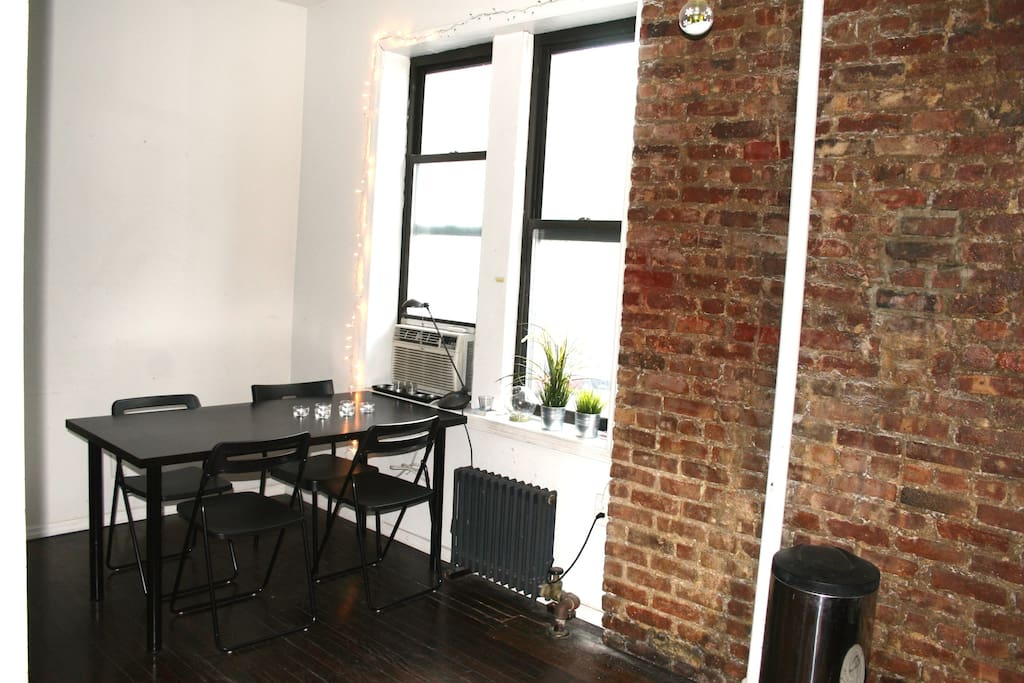 Classic Brooklyn exposed brick, windows overlooking the tree lined streets.