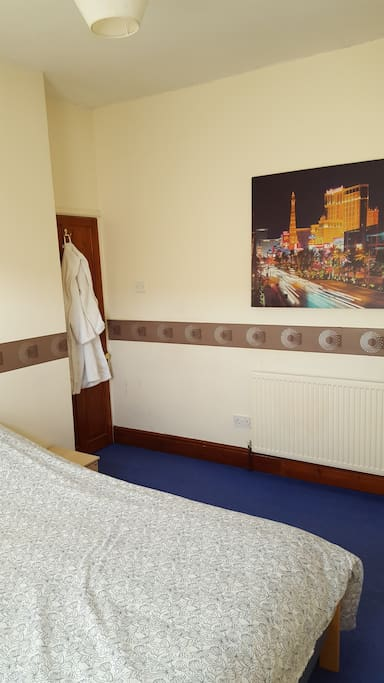 Bright, Comfy room with Double Bed and Luxurious Guest Bathrobe.