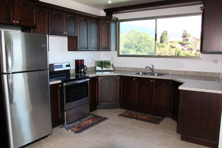 Large kitchen, granite countertops, stainless steel refrigerator, coffee maker, microwave, all the utensils you'll need.