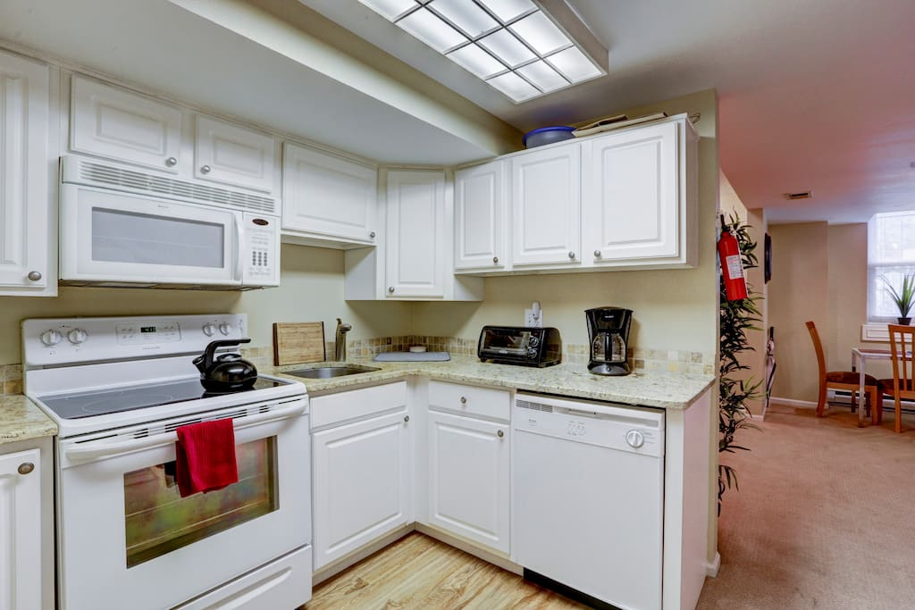 Kitchen is fully equipped with full size range, microwave, dishwasher and all kitchen basics for cooking