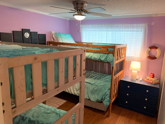 The bunk room hosts two bunk beds (so it has 4 twin beds in the room). There are ladders to reach the top safely, and in the closet also there is a safety rail if you wish to help someone from falling out of bed.