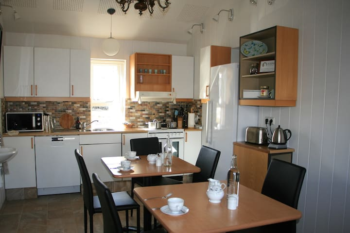 Fully equipped kitchen where guests can cook dinner.