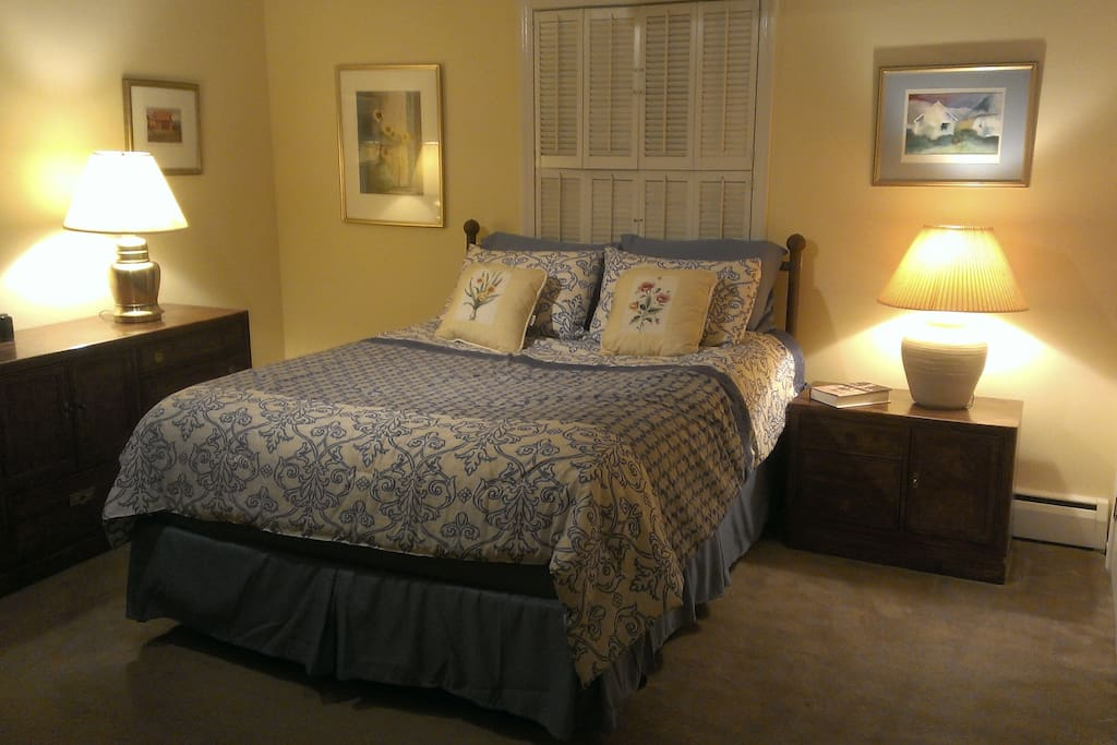 Private master with queen bed, closets and dresser space, and en suite bathroom