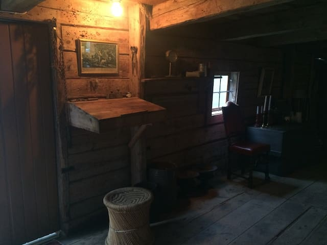 The entry door is to the left and the wood desk is where the head of the farm would sign in and out all bags of grain that was carried in our out of the farmhouse. It was built in 1780, and we are happy the house is no longer full of grain but instead can host guests from all over the world!