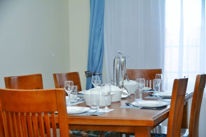 This lovely dinning room opens up to the kitchen making  serving meal times convenient