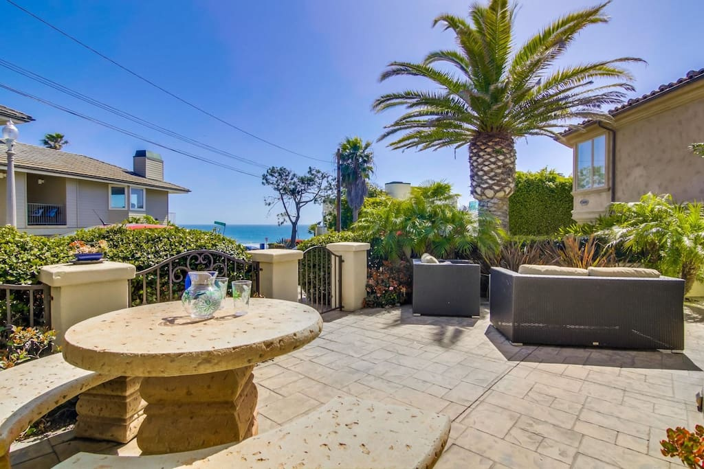 Front ground level patio with ocean views