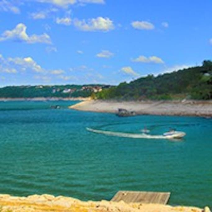 Boat from our dock on the largest cove on Lake Travis