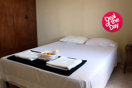 Cozy personal room with an attached toilet + shower, in a 2-bed apartment. Very close to airport - only 2-min drive. Airport pickup possible - please ask. Friendly host available for help with planning your stay in Fiji.