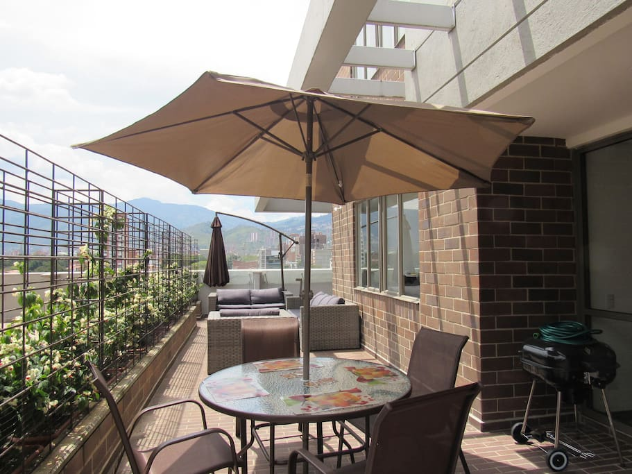 Outdoor dining area with outdoor barbecue