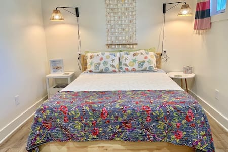 Room #3 at Folly River Lodge has a super comfortable queen-size foam mattress with night stands on both sides and soft bedding