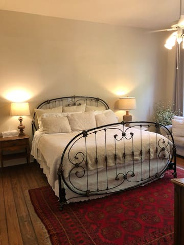 Primary bedroom with king sized bed, quality linens, and plush pillowtop mattress.