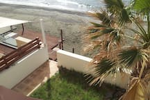 Veranda and steps to the beach (view from the balcony)