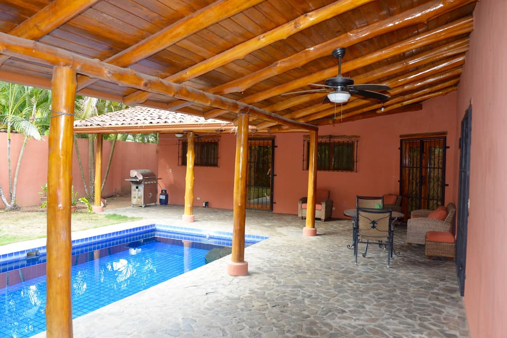 covered patio and pool