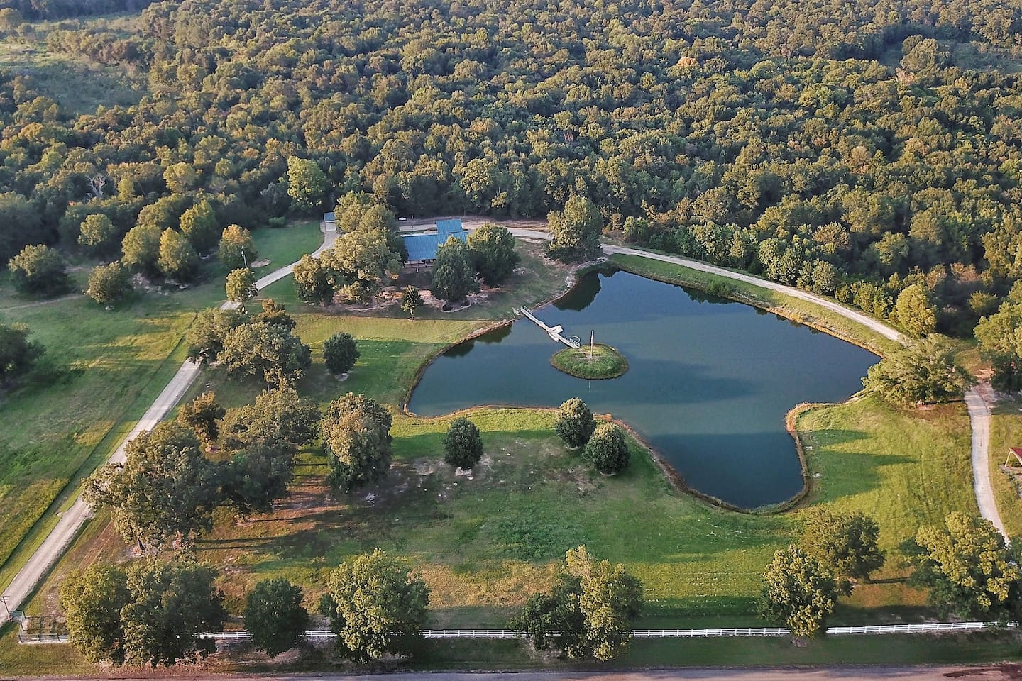 20 acres of Texas tranquility featuring woods, trails, meadows, 2 acre pond, salt water swimming pool, organic gardens, rescue animals, bird watching, peace and quiet.
