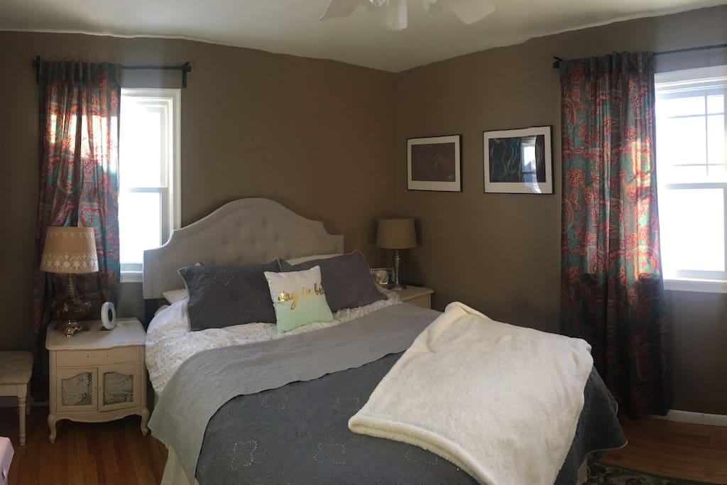 Master bedroom with queen bed and plenty of snuggly blankets