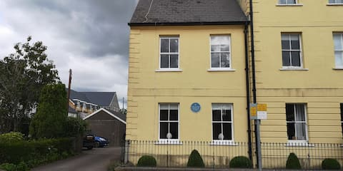 Period Townhouse with blue plaque.