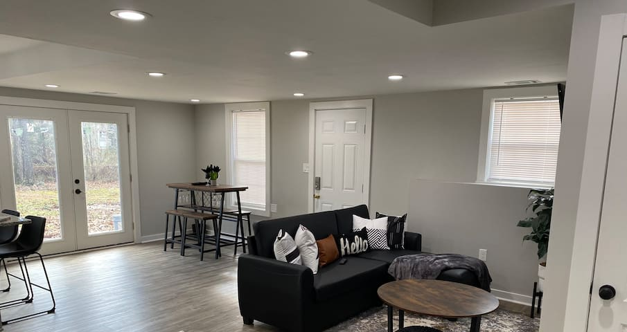 Living Space and Dining Area with Access to Backyard