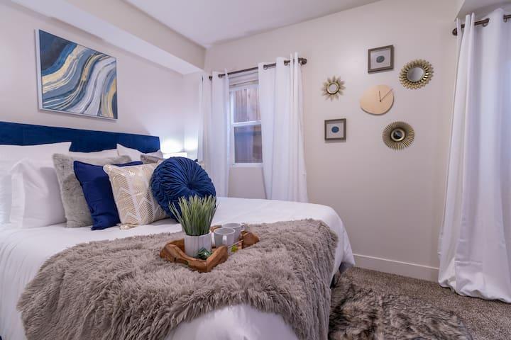 Bedroom with Queen bed and walk in closet