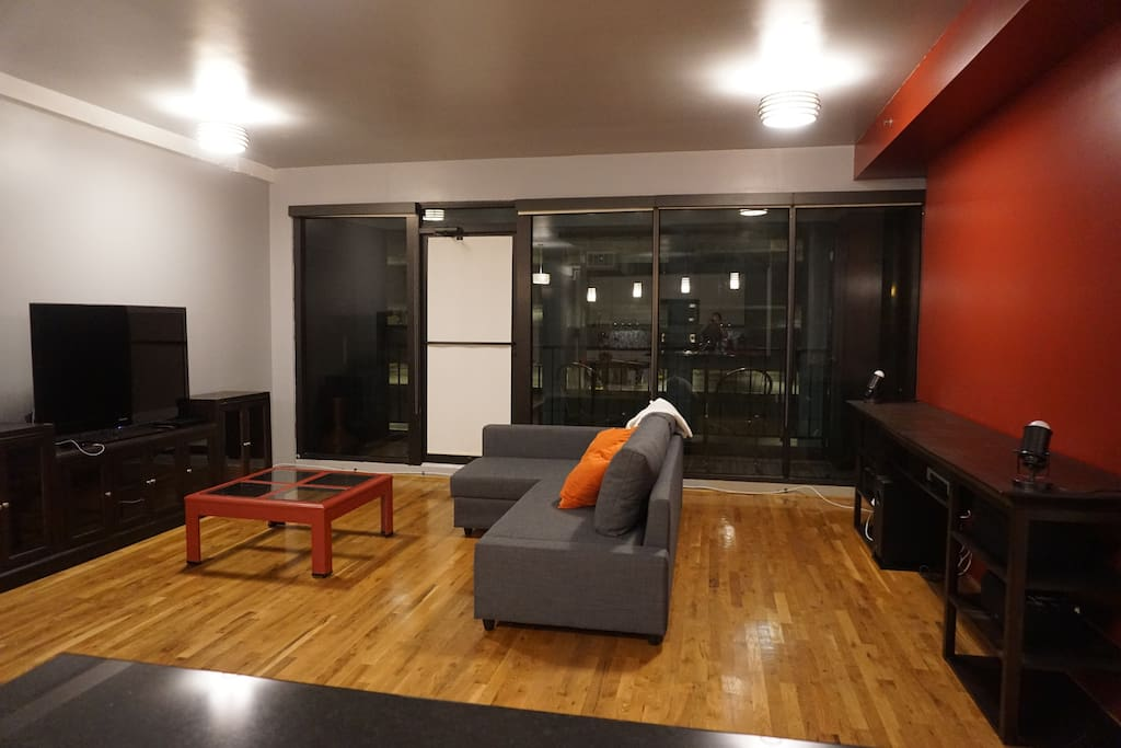 Spacious living room with private balcony and pull out bed.