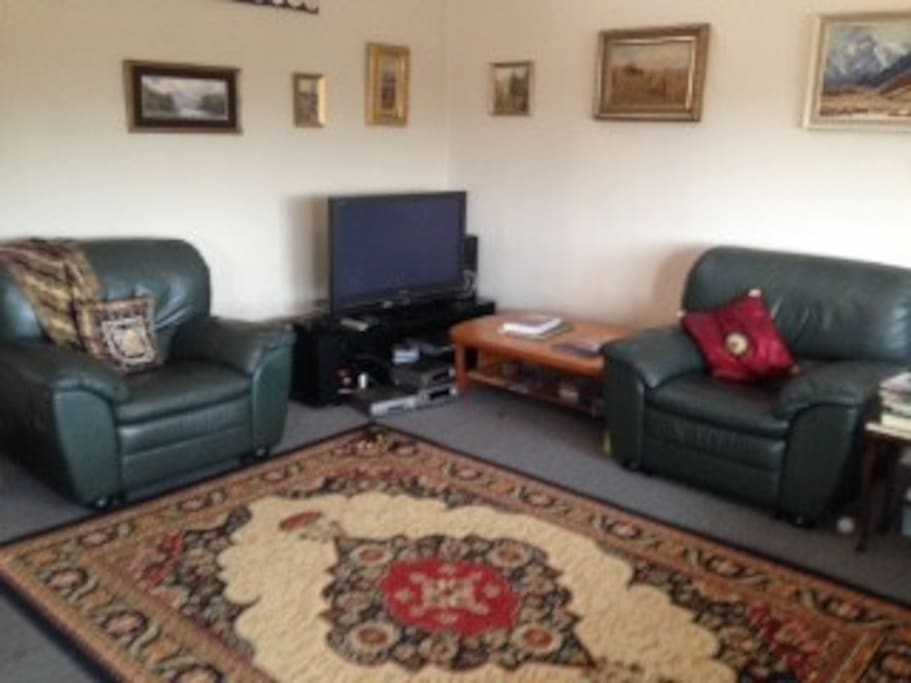 Relax in the leather lounge suite and watch TV