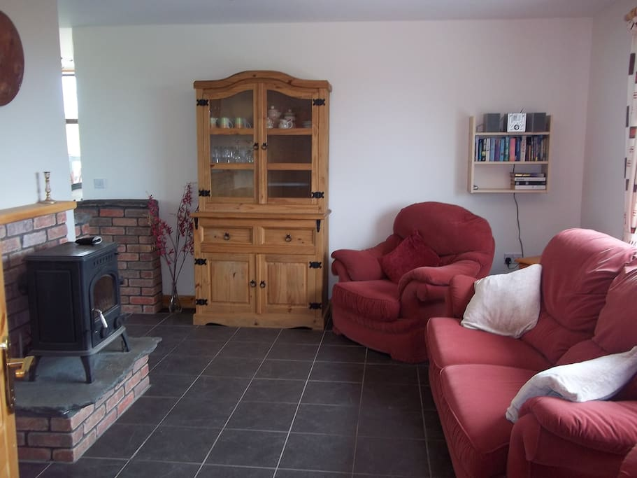 Living area with TV, DVD, Satellite Channels and Irish Channels, CD/Radio and wood burning stove