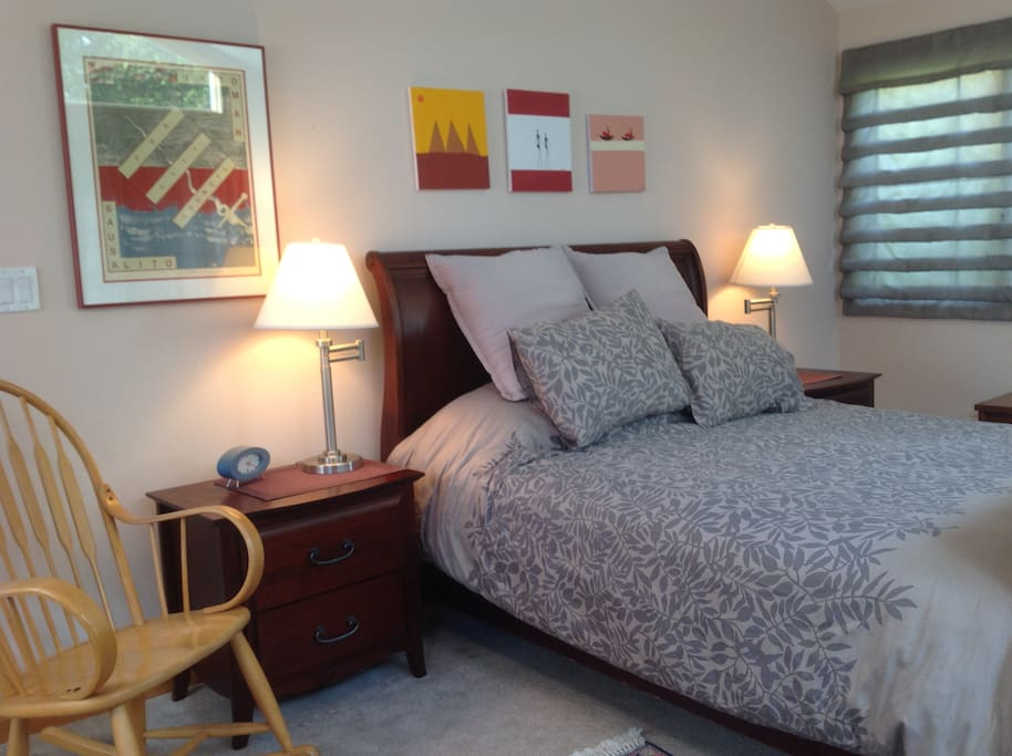 Queen bed with bedside tables and lights on both sides