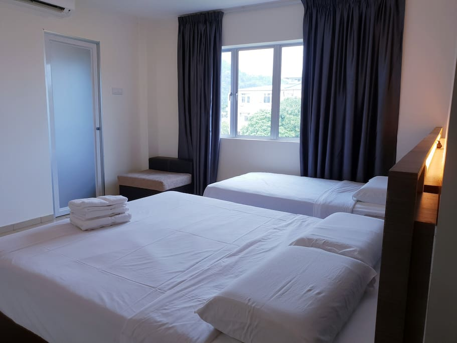 Grand Superior Room with window, suitable for 3 guests.