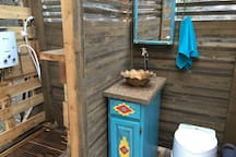 This is the semi-private bathroom with a hot rain shower and sink & potty.