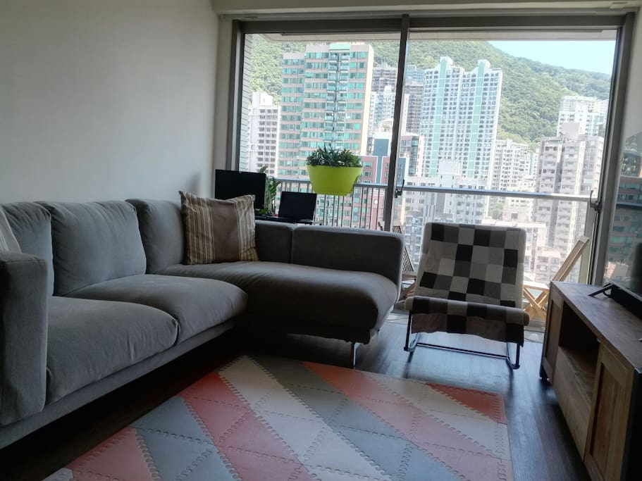 Large relaxing sofa overlooking the urban view