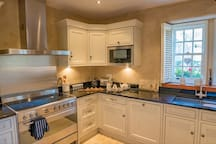 The kitchen is fully fitted with range master cooker, washing machine and tumble dryer.  A juicer is also available.