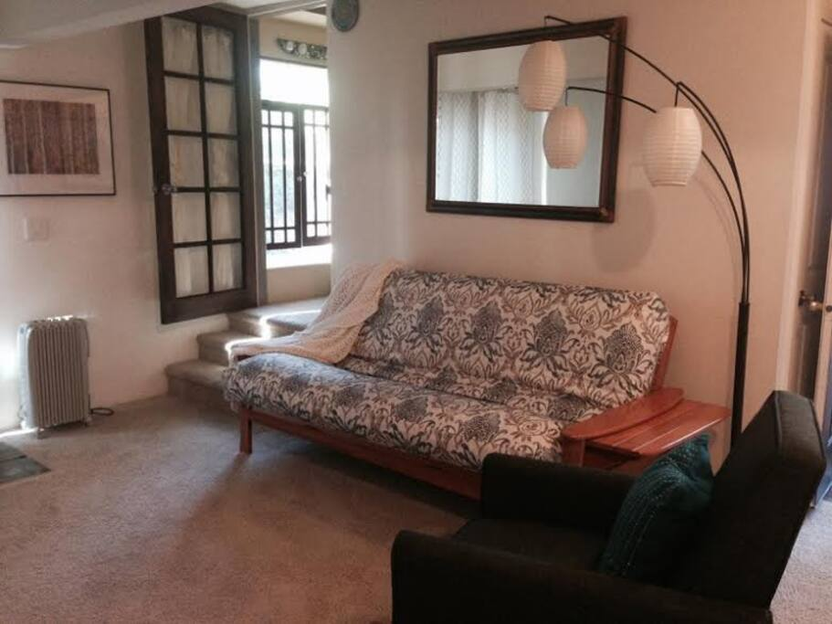 A separate living space with a comfy futon