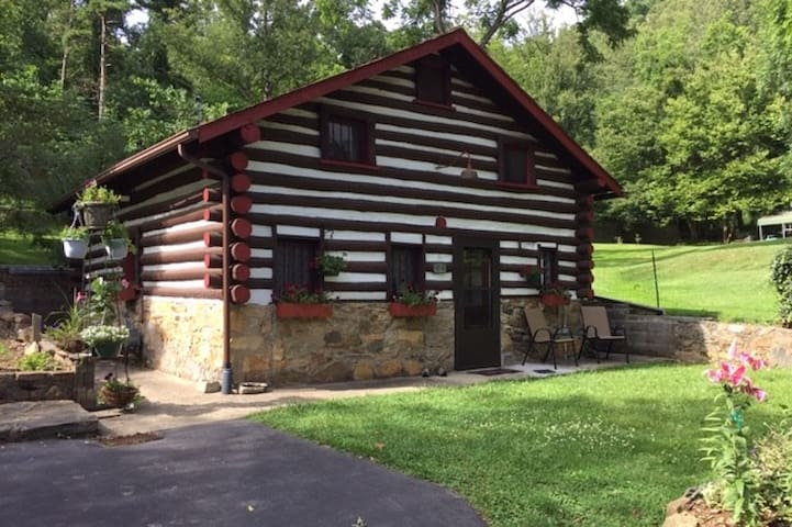 Comfortable log cabin on private park-like grounds