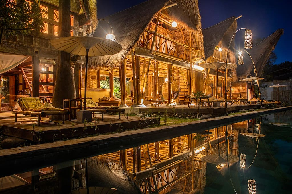 ligth design at bambu house and its reflection on the water