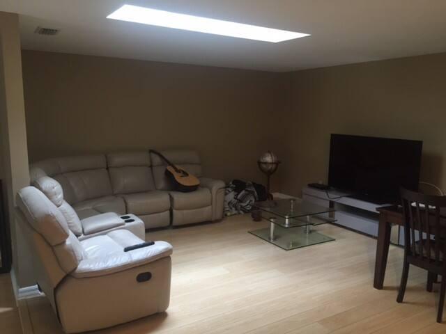 "Living Room - 65"" TV with Roku"
