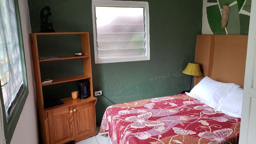 2 double beds in two rooms with bathroom in between.