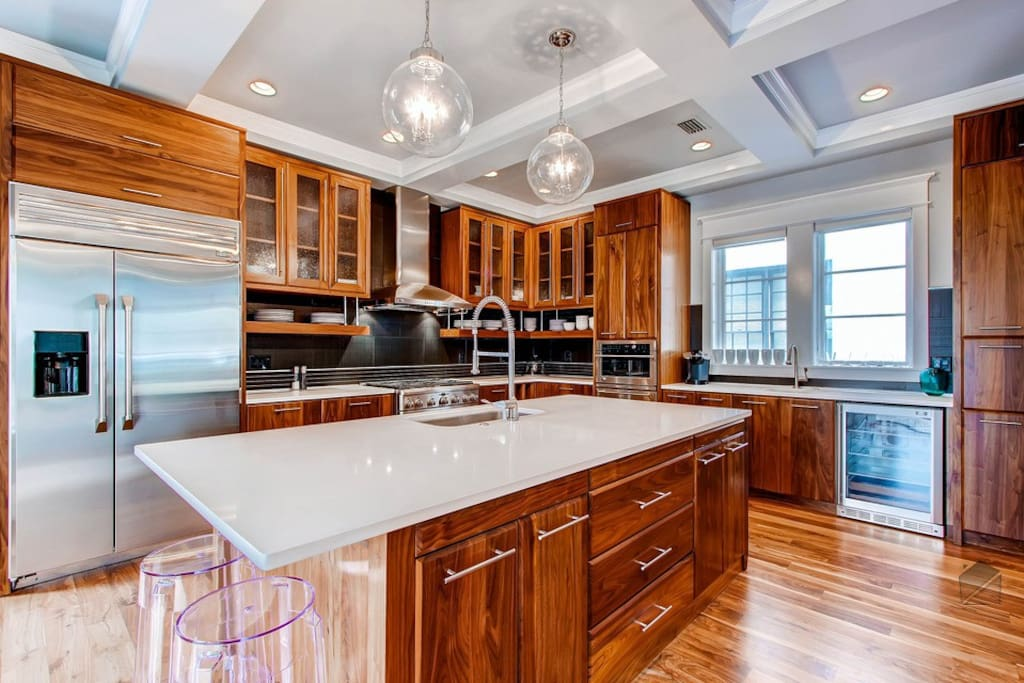The spacious kitchen has commercial-grade appliances, an island sink and a breakfast bar