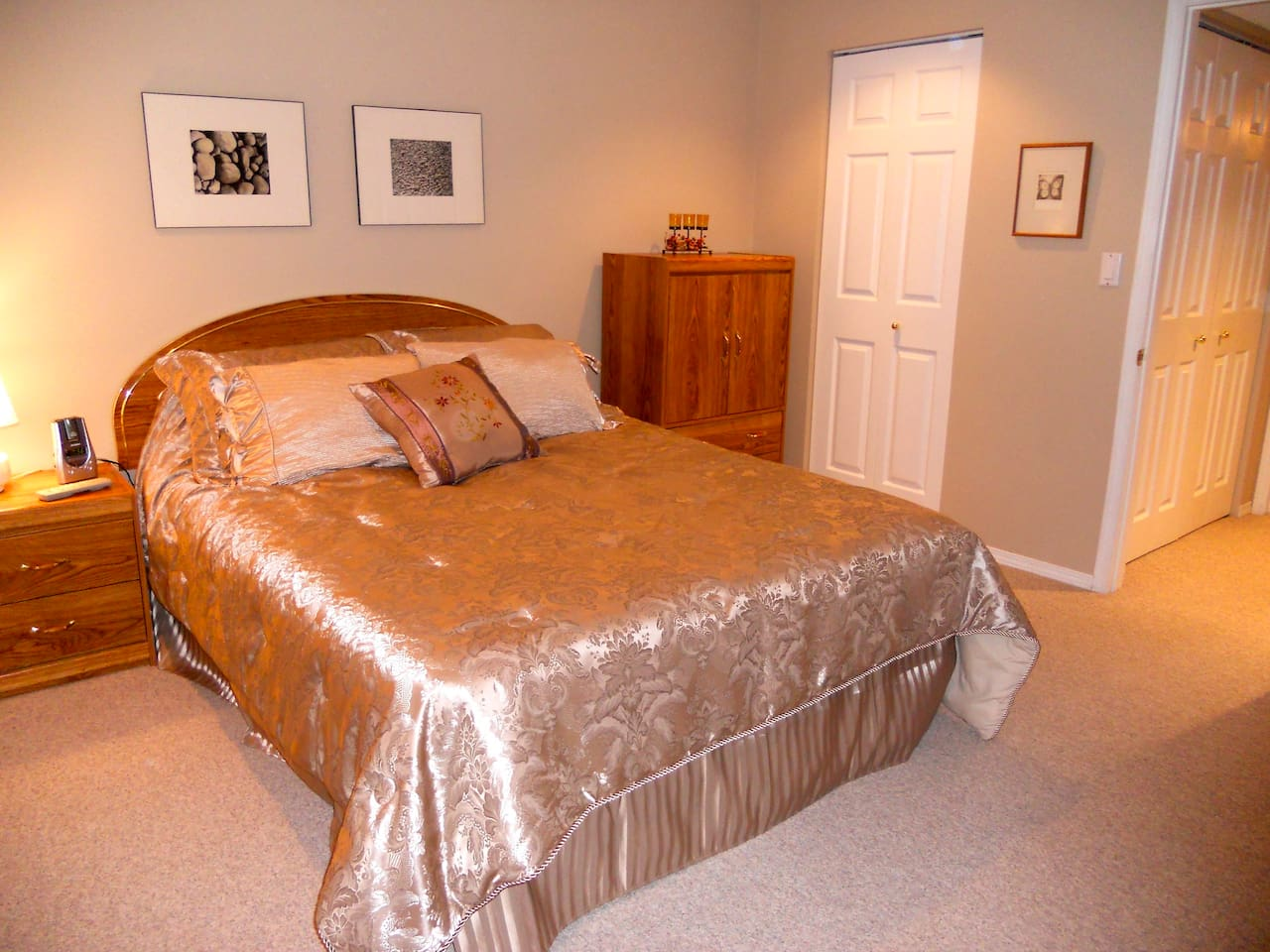 Queen bed in private room with bathroom next door
